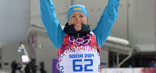SOCHI, RUSSIA - FEBRUARY 09:  Bronze medalist Vita Semerenko of Ukraine celebrates during the flower ceremony following the Women's 7.5 km Sprint during day two of the Sochi 2014 Winter Olympics at Laura Cross-country Ski & Biathlon Center on February 9, 2014 in Sochi, Russia.  (Photo by Harry How/Getty Images)